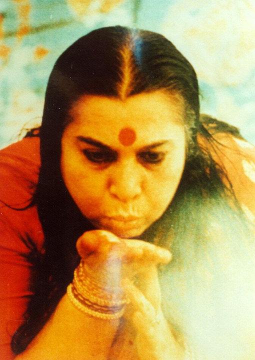 Shri Mataji blowing the cool breeze